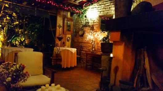 The outdoor patio in the evening.  There was a warm fire burning.