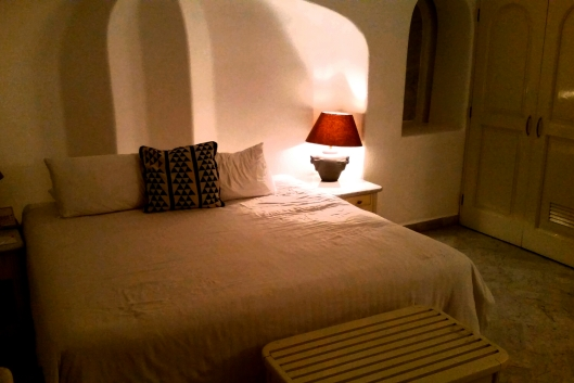White washed room with a large clam shell for a headboard.  All rooms overlooked the bay