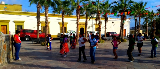 Children dancing on the plaza