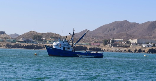 We were anchored next to this fishing boat in Turtle Bay.  On our way down with the Baja Ha Ha, Greg, Richard, Gary and I hiked up the mountain range you see on the right.  Going up was easy, coming down not so much.
