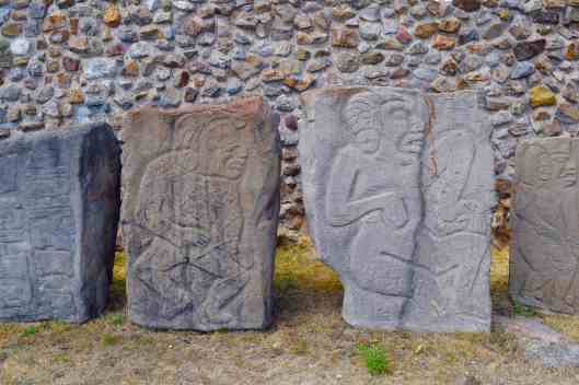 Stone carvings.  If the eyes are closed, the person is deceased.