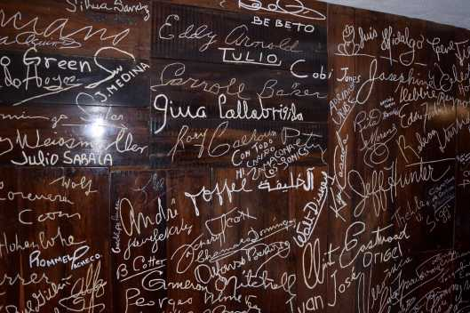 One of the walls with the autographs of celebrities who have come to watch the show.