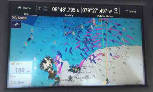 The yellow arrow is pointing to Sereno II and the red line indicates our course.  The triangles are ships at anchor waiting to transit or in a few cases were under way.  The pink areas represent rain.  The red X closest to us is the beginning of the channel to the canal.  The red X further away is the marina we were headed to.   Okay boring no longer!