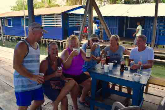 We headed to one of the outer islands to watch some boat races.  The kitchen at this restaurant is the little building to the left.  Liz brought her own bottle of rum.  Add some coke and ice and we had ourselves a party.