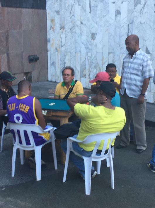 Taxi drivers playing dominoes while waiting for their next fare.